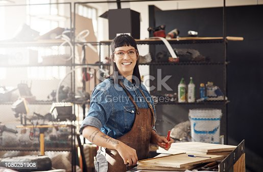 Cropped portrait of an attractive young woman working in her creative workshop
