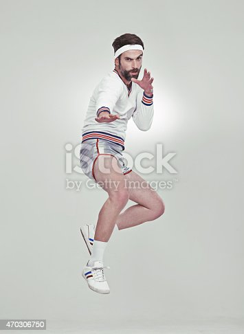 A young man in the studio wearing retro sportswear and shadeshttp://195.154.178.81/DATA/i_collage/pi/shoots/797342.jpg