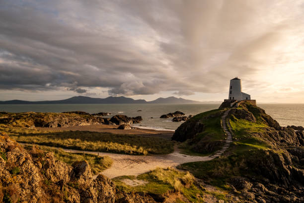 Llanddwyn Island, Anglesey, Wales with Obsolete Lighthouse Obsolete lighthouse on this island of myth and legend. Image recorded at sunset. wales stock pictures, royalty-free photos & images