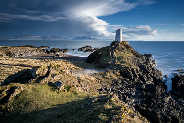 Llanddwyn Island Lighthouse How many beaches how views like this? Absolutely amazing!  wales stock pictures, royalty-free photos & images