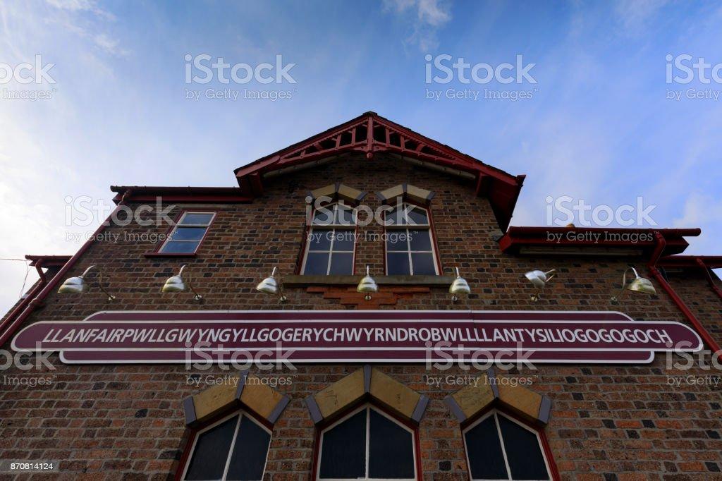 Llanfairpwllgwyngyll railway station sign Llanfairpwllgwyngyll railway station sign; Wales Anglesey - Wales Stock Photo