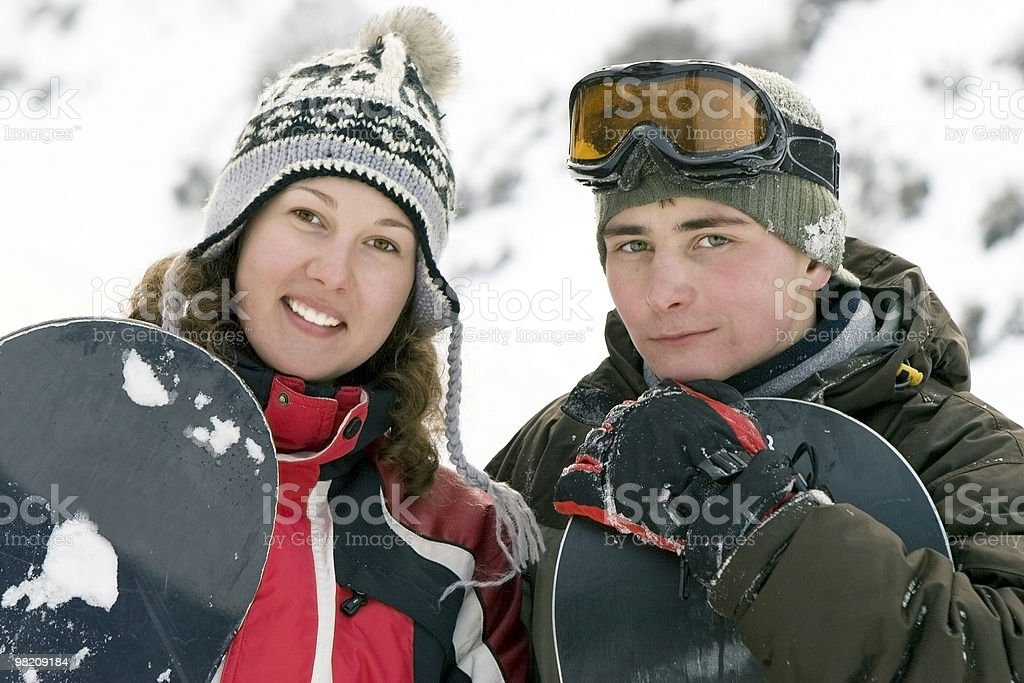 Llifestyle image of two young adult snowboarders royalty-free stock photo