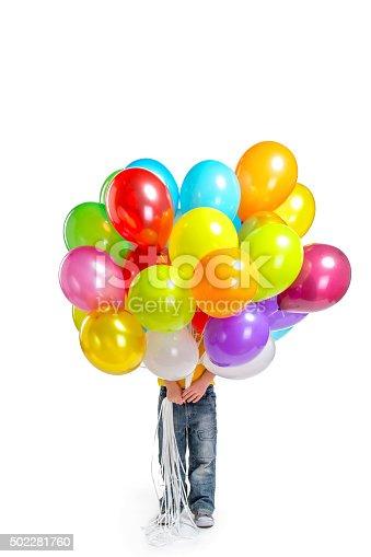 istock Llittle boy hiding behind balloons 502281760