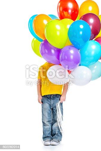 istock Llittle boy hiding behind balloons 502282014