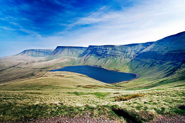 Llyn Y Fan Fach Dammed Lake, Llyn Y Fan Fach on the Western boarder of the Black Mountains (in the Brecon Beacons) near Llanddeusant Carmarthenshire, Wales. This is the lake from the folk tale of 'lady of the lake' and the Physicians of Myddfai.  brecon beacons stock pictures, royalty-free photos & images