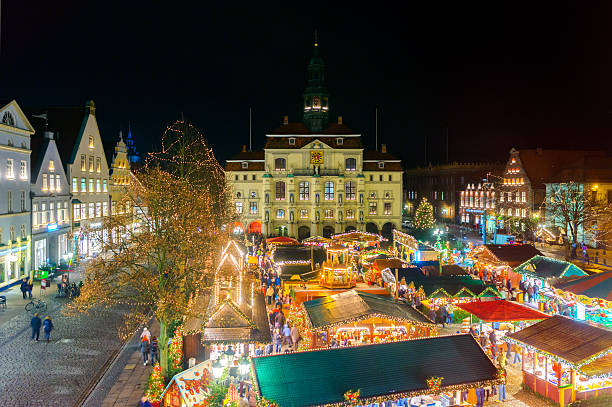 Lüneburg (Luneberg) Christmas Market View on Luneburg´s christmas market and town hall at night. lüneburg stock pictures, royalty-free photos & images