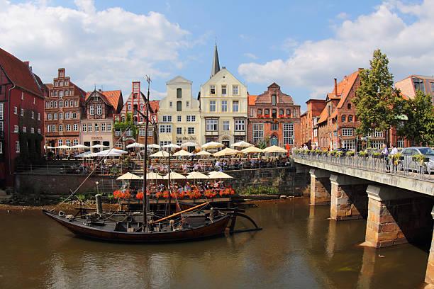 Lüneburg Stintmarkt Lüneburg, Germany - 21.August 2013: Cafes and restaurants in the old port in Lüneburg with the river