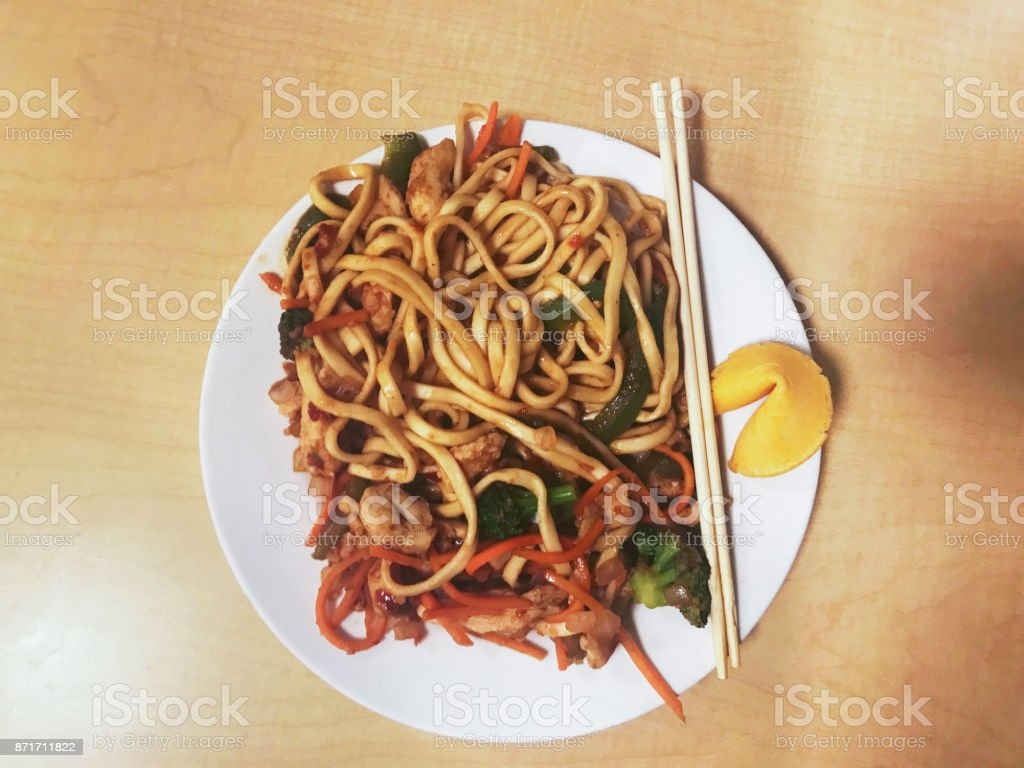 Lo mein noodles and a fortune cookie for lunch stock photo