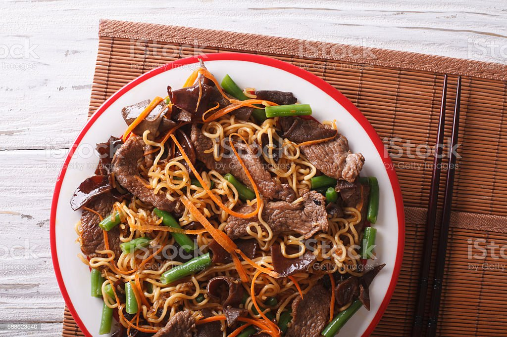 Lo mein with beef, muer and vegetables closeup stock photo