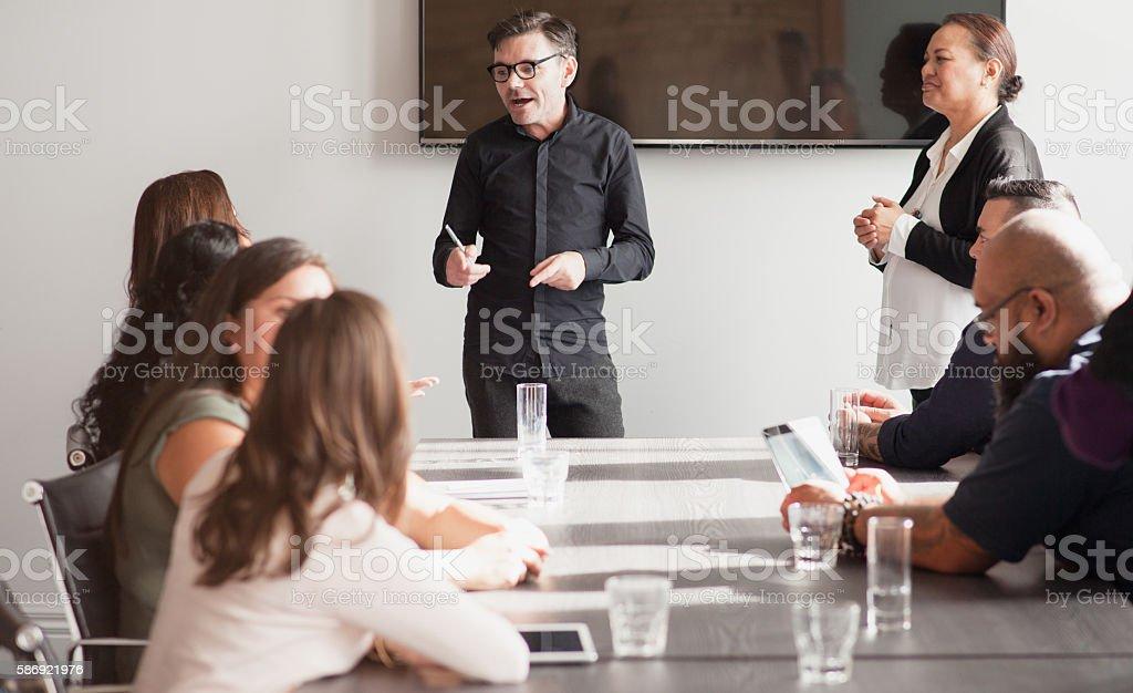 Loack Kiwis in a meeting. stock photo