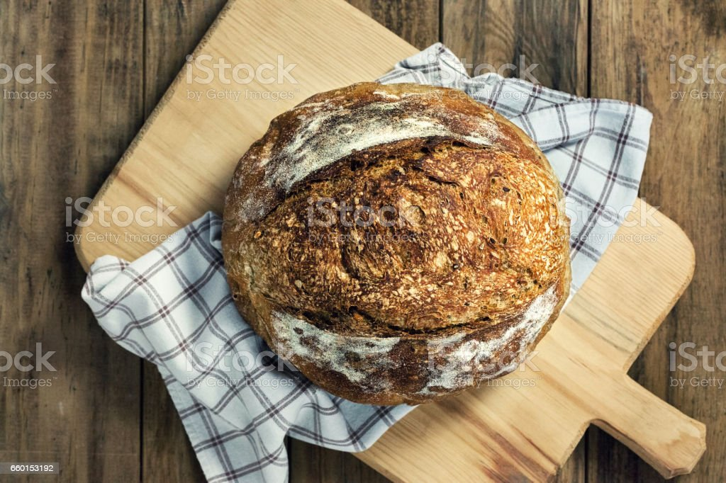 Load of bread on cutting board stock photo