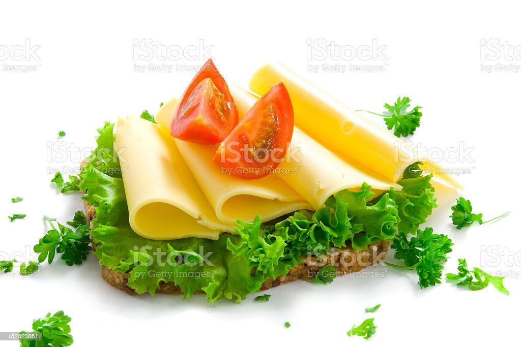 A load of wheat bread with lettuce, cheese and tomato royalty-free stock photo