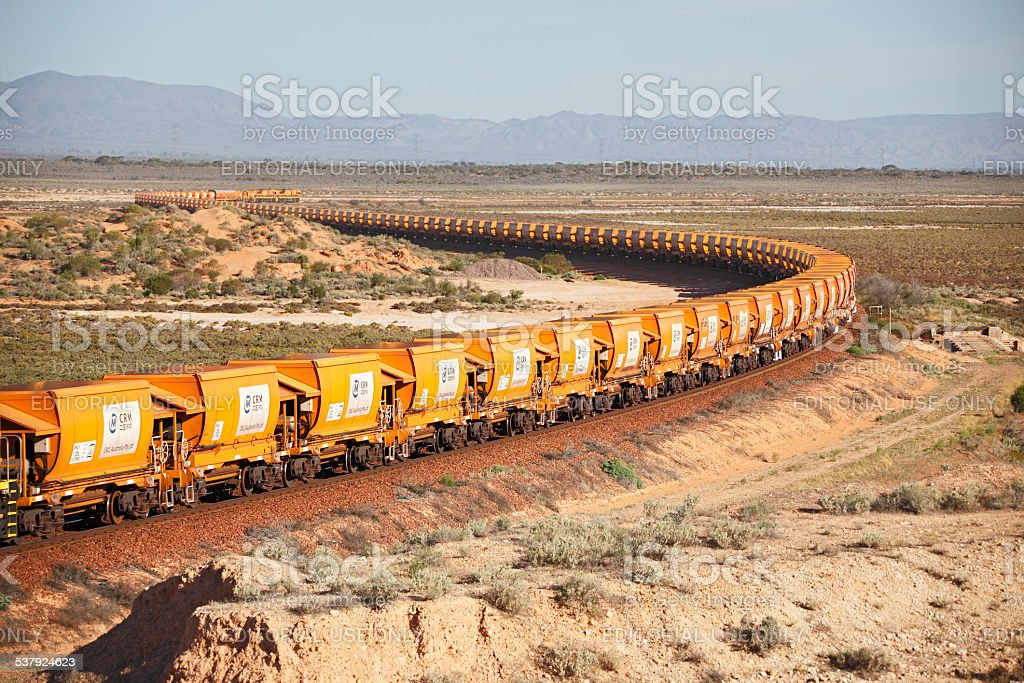 Loaded Arrium iron ore train snaking through outback stock photo