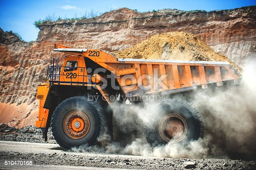 istock Loaded big yellow mining truck. 510470168