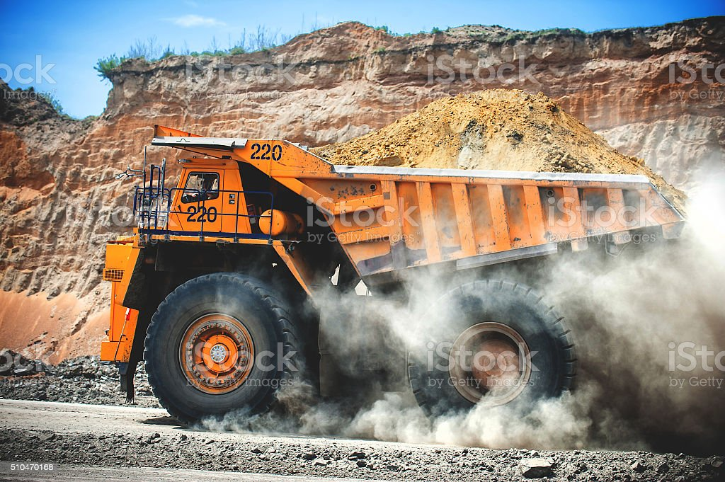 Loaded big yellow mining truck. stock photo