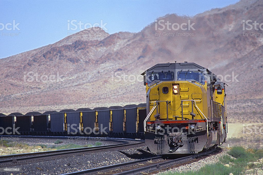 Loaded coal train with mountain background stock photo