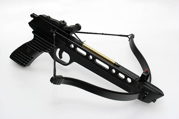 loaded crossbow handgun - crossbow stock pictures, royalty-free photos & images