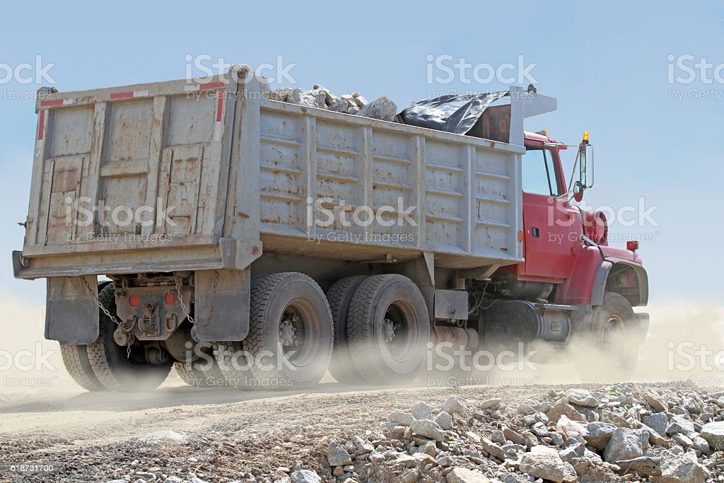 Loaded Dump Truck On New Road Construction Site stock photo