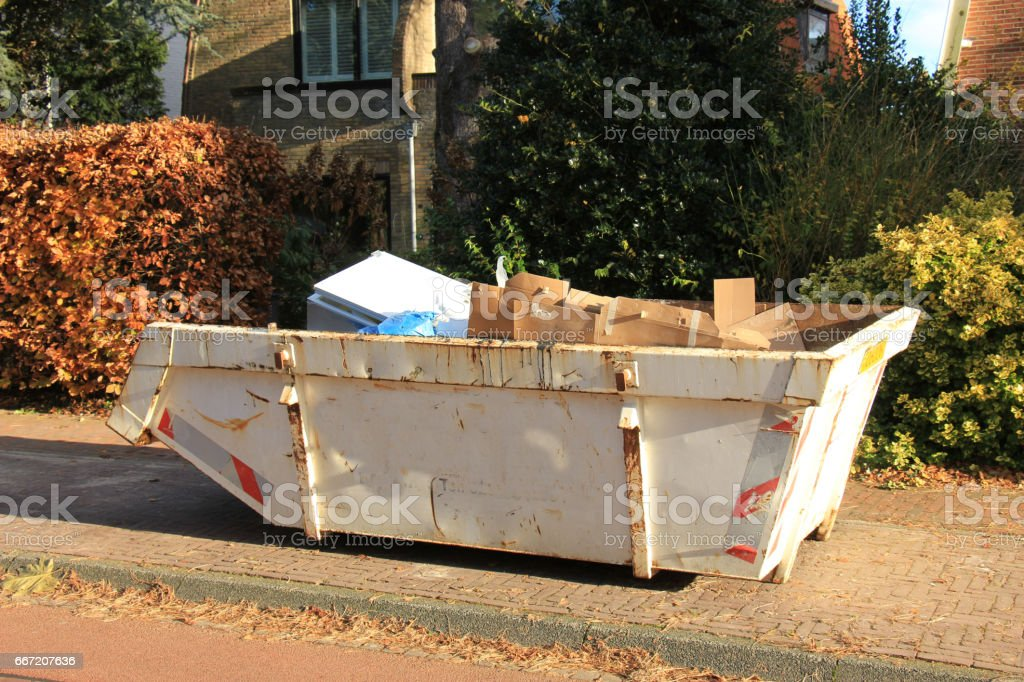 Loaded garbage dumpster stock photo