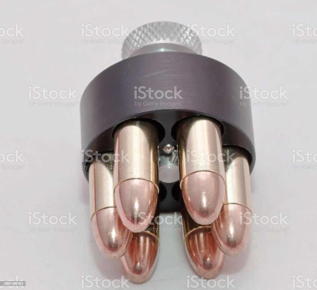A loaded revolver speed loader stock photo