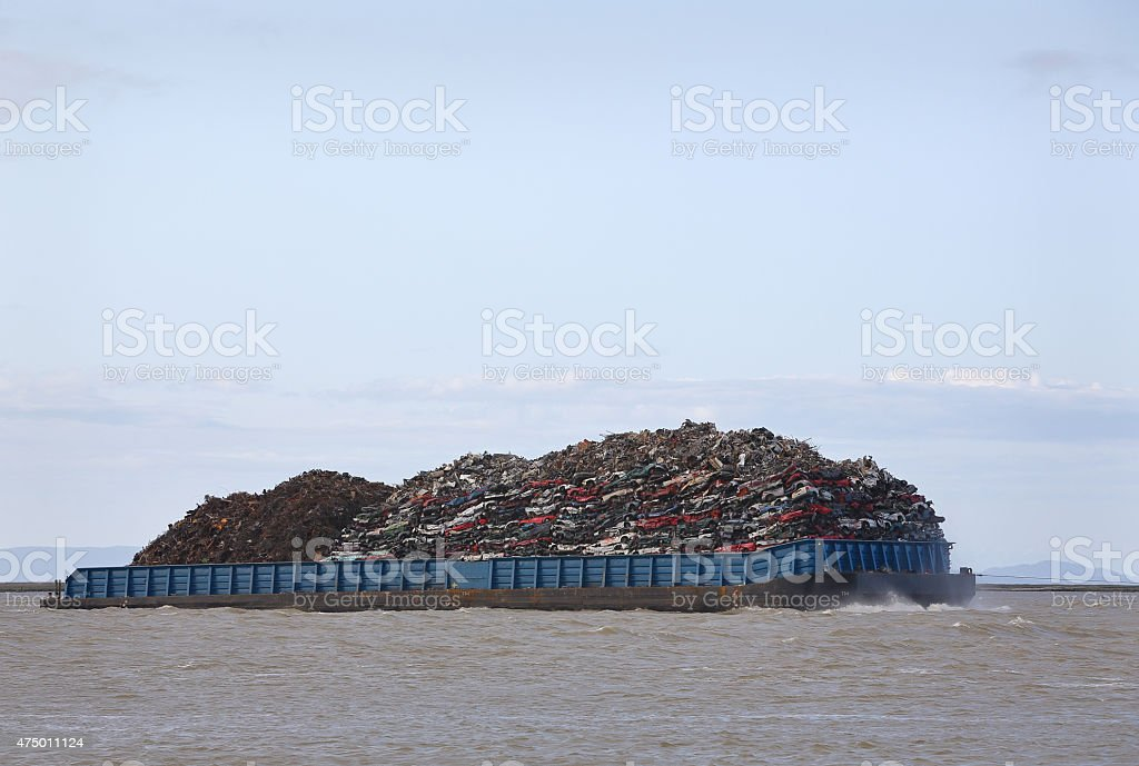 Loaded Scrap Metal Recycling Barge stock photo
