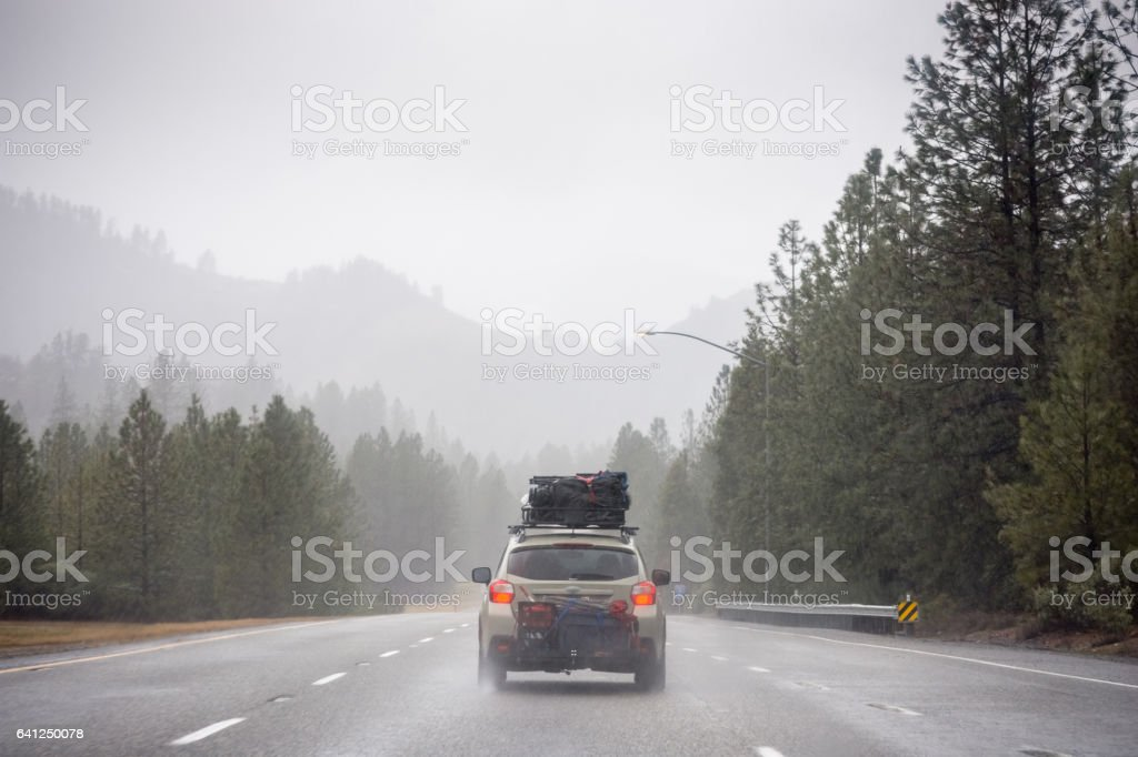 Loaded up family car on rainy Pacific Northwest road trip royalty-free stock photo