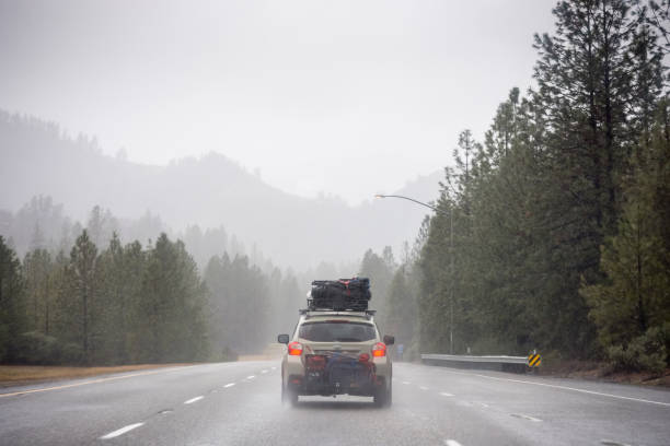 Loaded up family car on rainy Pacific Northwest road trip stock photo