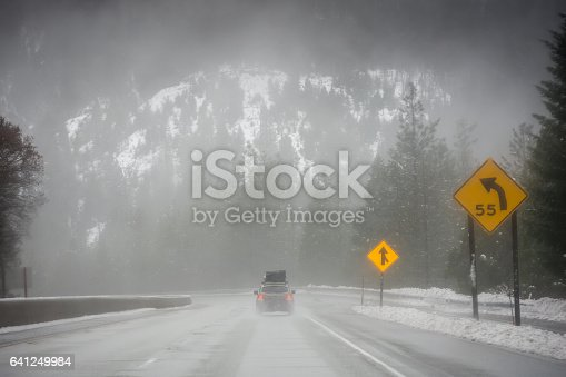 144334852istockphoto Loaded up family car on snowy Pacific Northwest road trip 641249984