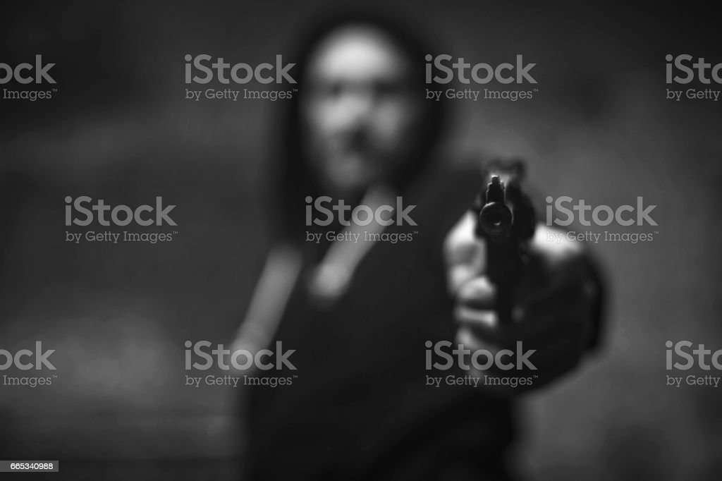 Loaded wicked criminal pulling a gun on somebody stock photo