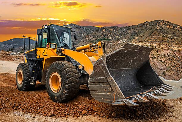 Loader Excavator at sunset stock photo