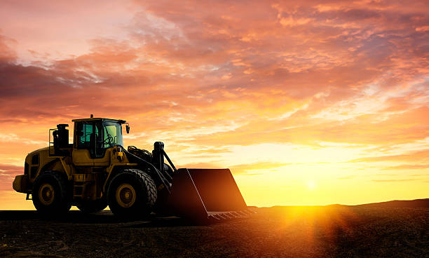 Loader Excavator at sunset stock photo