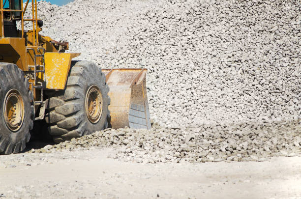 Loader Scooping Lime Rock stock photo