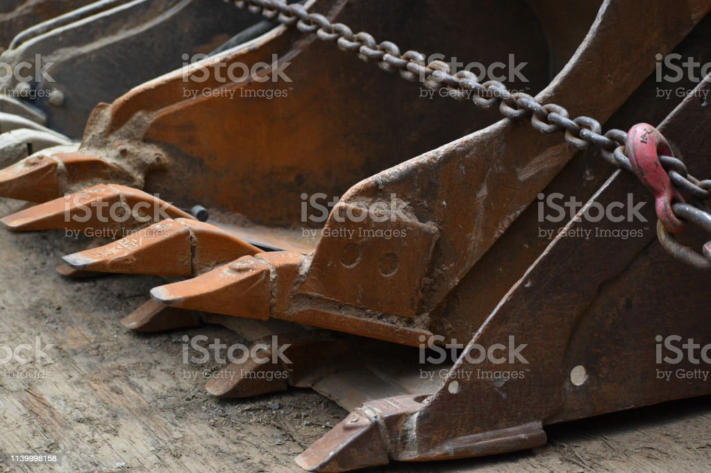 Loader Scoops Chained to Flatbed Trailer stock photo
