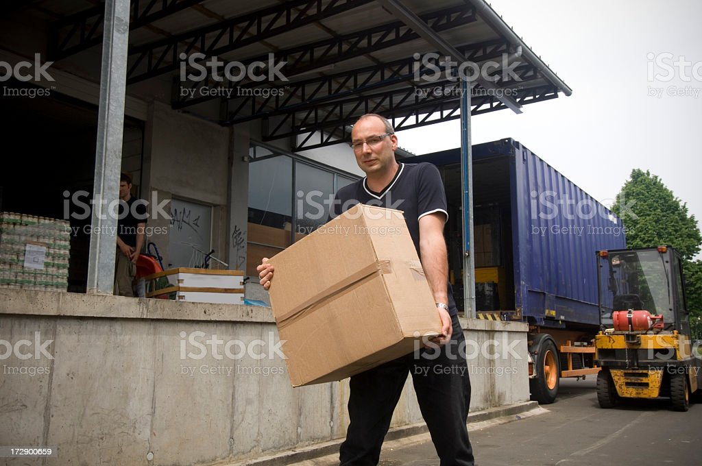 Loading a truck royalty-free stock photo
