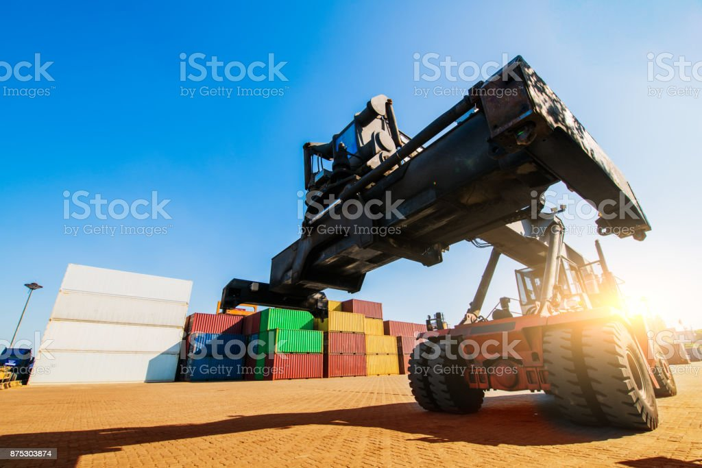 Loading and unloading of containers in the port on a bright sunny day stock photo