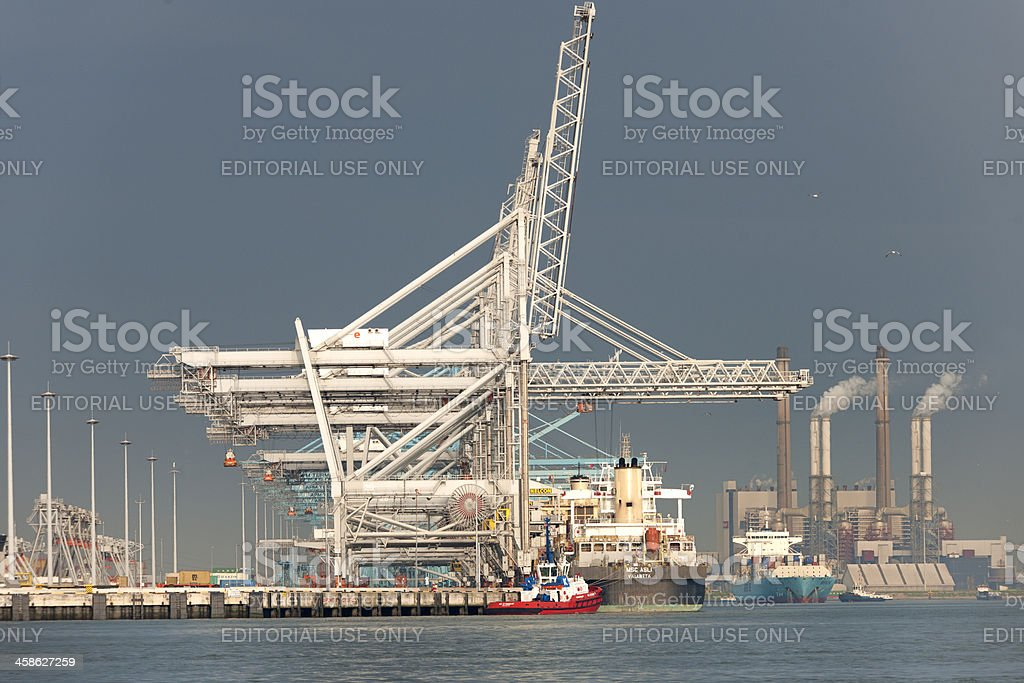 loading cargo container ship in commercial dock stock photo