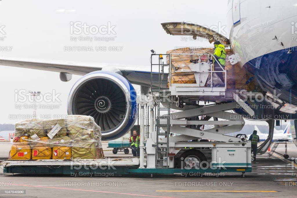 Loading cargo into the aircraft before departure in Domodedovo airport in Moscow Russia stock photo