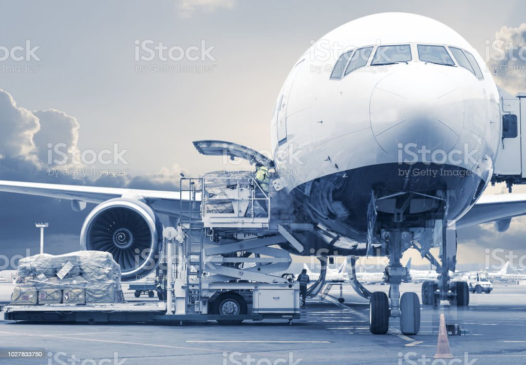 loading cargo picture in a blue toning stock photo