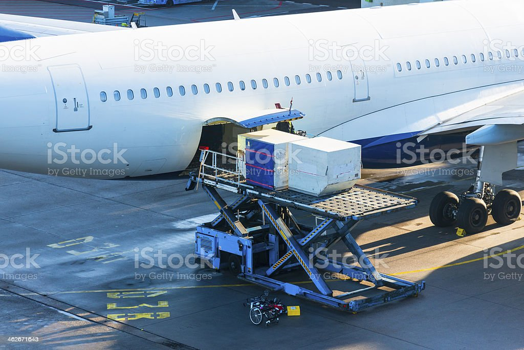 Loading Cargo to Airplane stock photo