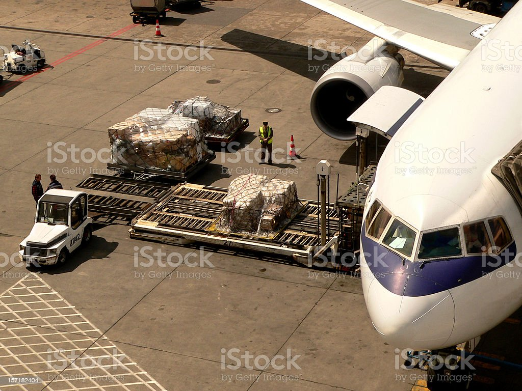 Loading cargo to boeing stock photo