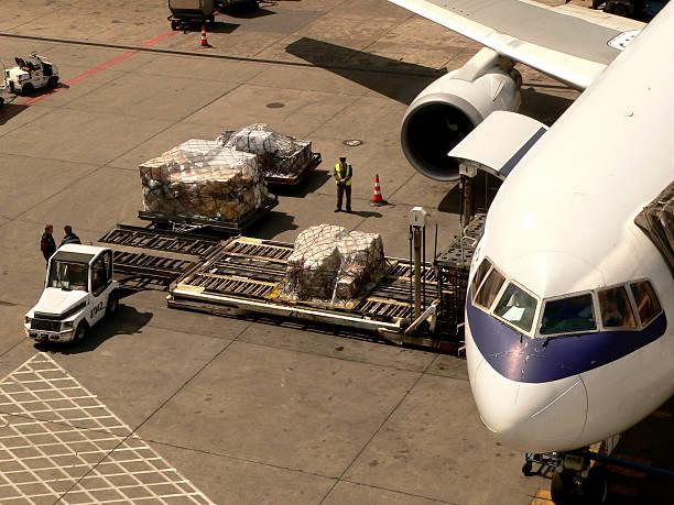 Loading cargo to boeing stock photo