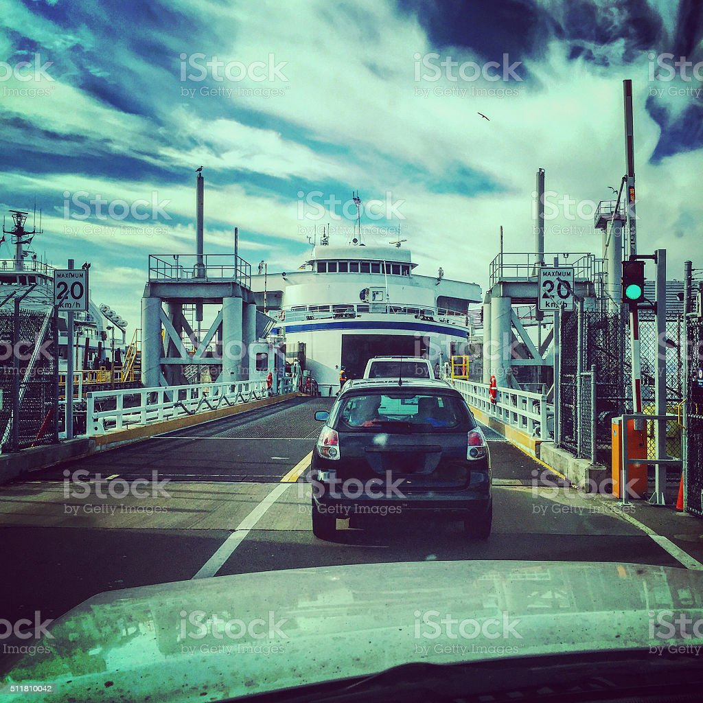 Loading cars onto ferry stock photo