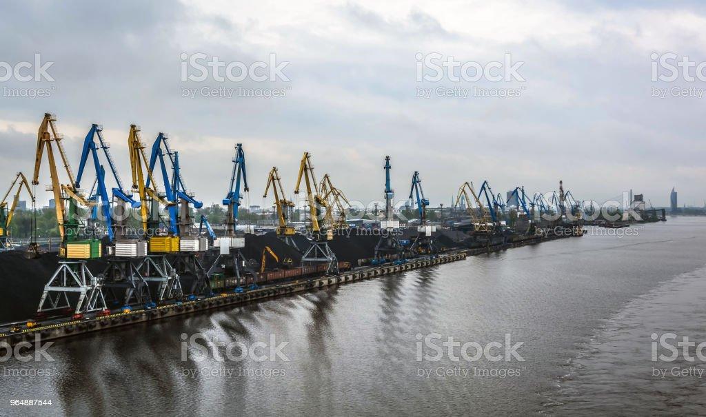 Loading coal in port. Industrial scene. royalty-free stock photo