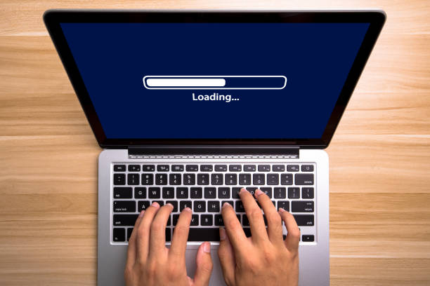 Loading Concept Laptop Screen With Typing Hands On Keyboard stock photo