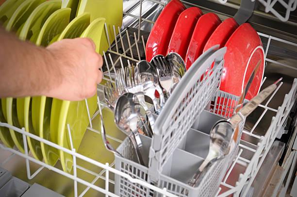 loading dishwasher stock photo