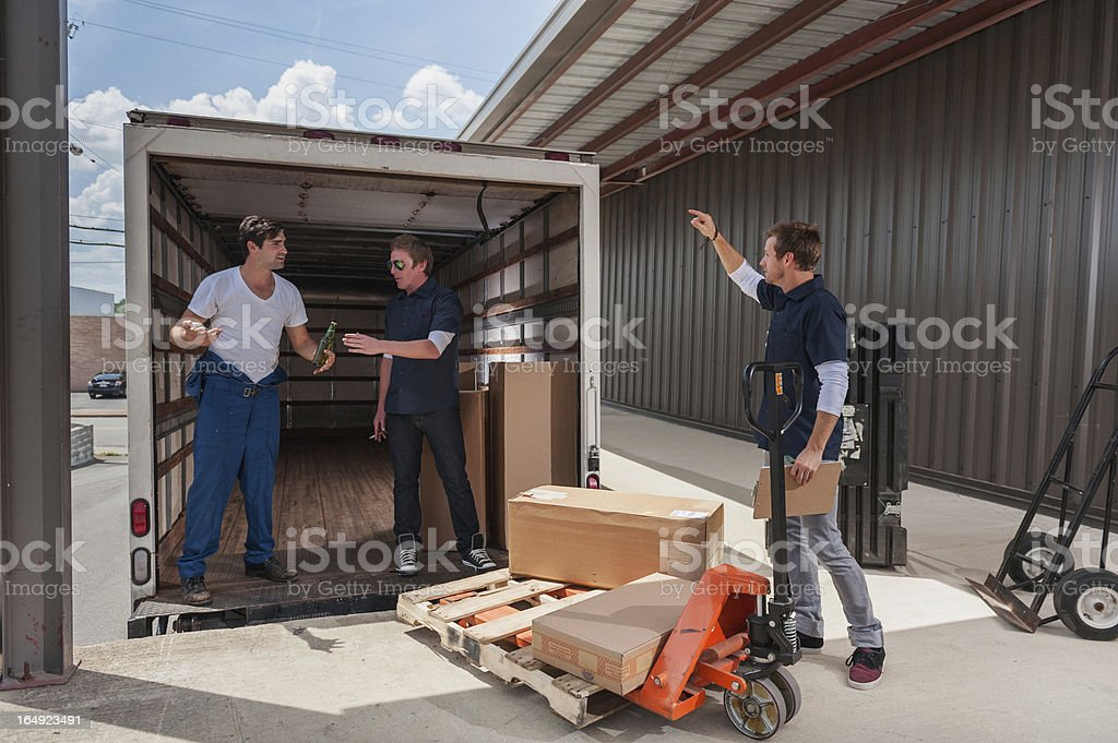 Loading Dock Boss Catches Workers Drinking On The Job royalty-free stock photo