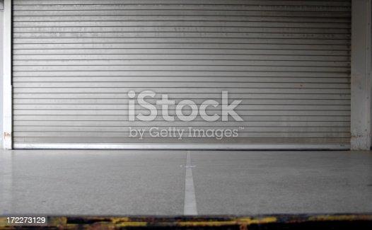 Closed door of a loading dock shot from floor level.