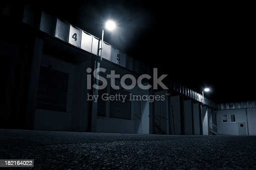 istock Loading Dock, Empty parking place before a warehouse 182164022