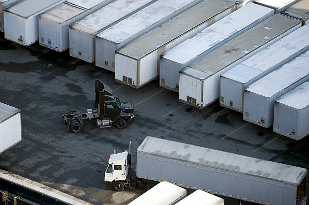 loading docks - lorries unloading stock photos and pictures