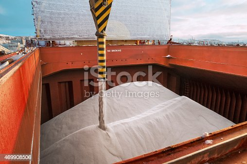 Loading fertilizer into the hold of the ship shiploader  (close-up)